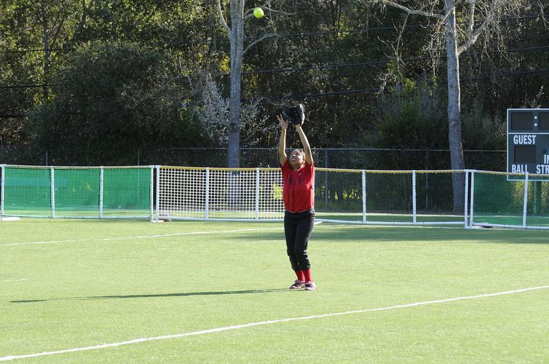 Castilleja Softball 1/ 500s, at f/6.7 || E.Comp:0 || 105mm || WB: AUTO 0. || ISO: 560 || Tone:  || Sharp:  || Camera: NIKON D300on: 2009:03:10 16:39:47