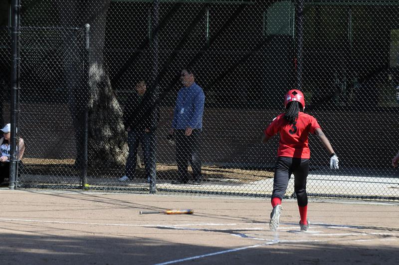 Castilleja Softball 1/ 1000s, at f/5.6 || E.Comp:0 || 135mm || WB: AUTO 0. || ISO: 400 || Tone:  || Sharp:  || Camera: NIKON D300on: 2009:03:24 15:48:49