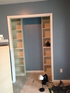 Removed closet doors, installed bookshelves, added closet rods.