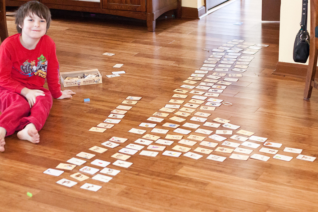 Day 101  Ian and I played his version of Munchkin today. In his version, we get as many cards as we want and if we don't like a card we can just discard it, so nothing bad really ever happens. I'm looking forward to when Ian enjoys following the rules of games. I did enjoy hearing his latest computation and reading skills as he counted up his bonus points and read the cards.