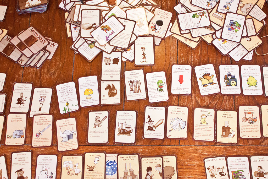 """Week 08 {wide angle} <br /> <br /> My six year old played Munchkin with his dad Saturday afternoon and he created a very very very complicated character. He chose all these cards to represent him.  :D<br /> <br /> I practiced wide angle photography this week for my Project 52. I had to dust off my kit lens for it because I only have that and the 50mm 1.8 that is always on my camera. And then I forgot to decrease the focal length as small as it will go (18mm)! This is 28mm.<br /> <br /> Go to the blog circle at <a href=""""http://michelepixels.com/2013/02/24/week-08-wide-angle-complicated-character/"""">http://michelepixels.com/2013/02/24/week-08-wide-angle-complicated-character/</a>"""
