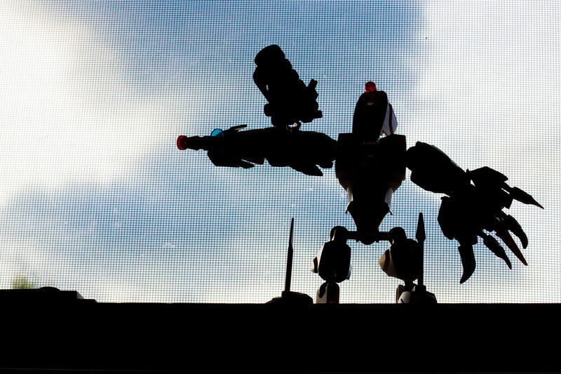 "Week 18 {silhouette} Giant Battle Droid --  I didn't manage to get a silhouette of a person this week and had to resort to a toy on Saturday evening. I carefully posed the battle droid to make his silhouette interesting though, and put a bit of thought into the crop. Is there a way I could have eliminated the window screen in post-processing? I know now I should have just gone outside. An interesting thing about this is that what you probably perceived as blue sky is actually clouds. The sky was getting getting overcast. I raised the vibrancy to make the little lights on the droid stand out and I liked what it did to the sky, adding some color and texture.<br /> <br /> Go on the blog circle at <a href=""http://wp.me/pclGd-12v"">http://wp.me/pclGd-12v</a>"