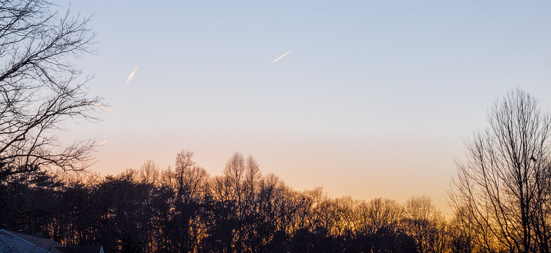 airplane trails at sunset