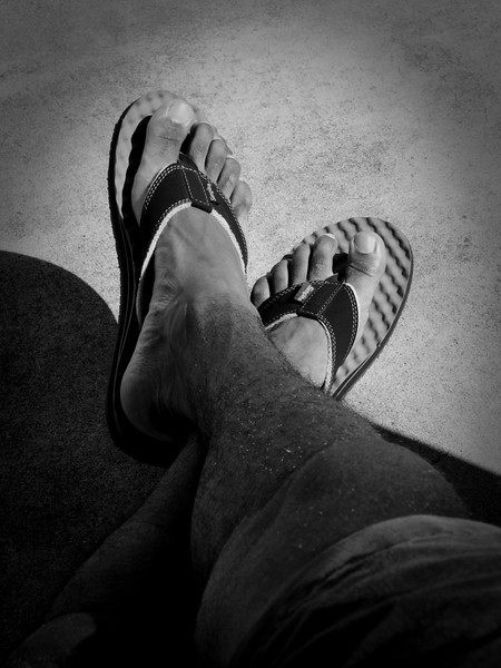 "October 6, San Mateo, CA: Insecure.  I was feeling insecure earlier today.  Seems like there are thousands of things that can make us feel that way.  But most of them would probably go unnoticed by almost everyone.  And none of them would cause the ones who love us to judge.  But remembering that can be so damned hard.  ""Wearing flip-flops"" is a phrase that I use as a reminder to extend myself to areas and situations where I might feel vulnerable."