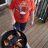 March 31, 2012 - Grill Master No. 2. No. 1 son readies some food for UK-UofL. (106/366)