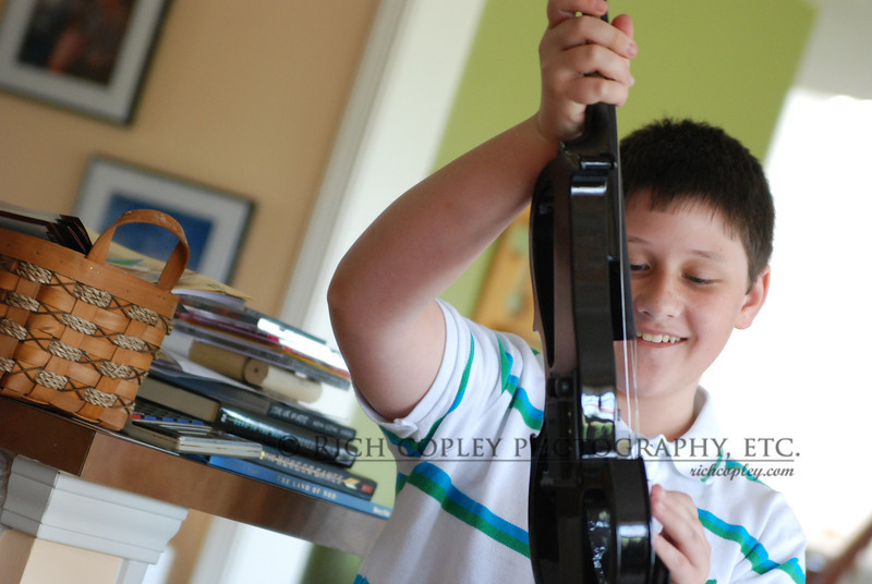 May 27, 2012 -- No. 1 son checks out one of his birthday presents. (164/366)