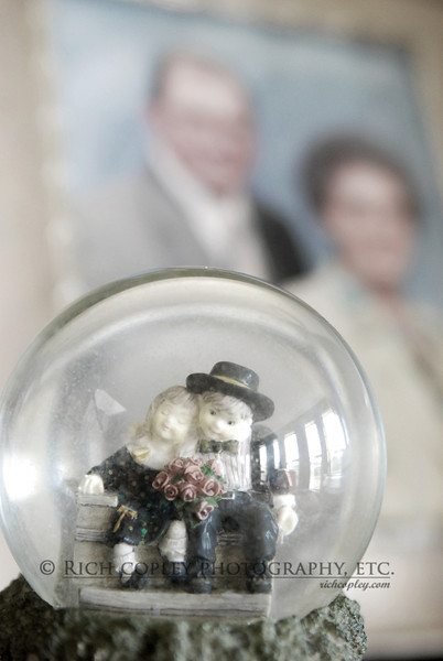 Aug. 23, 2012 - A snowglobe I gave Kate for one of our anniversaries on a cabinet with a portrait of her parents, who have been married well over 50 years. (252/366)