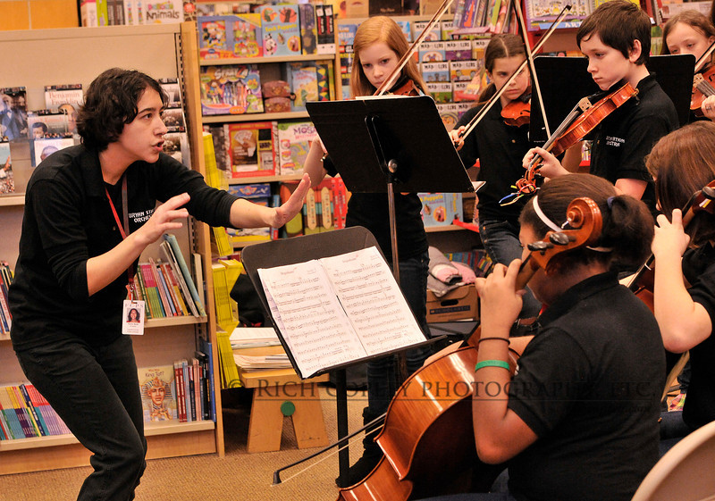 Feb. 4, 2012 - Was taking pictures at No. 1 son's orchestra performance this morning at Barnes & Noble. At this moment, I was really just standing to the side watching when the orchestra teacher got really animated, and the camera viewfinder was up to my eye faster than Raylan Givens can draw his sidearm. (51/366).