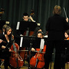 March 8, 2012 - No. 1 daughter had an orchestra concert tonight. Since it was a prep concert for the Kentucky Music Educators Association competition, the atmosphere was pretty serious, so I mostly confined my shooting mostly to the sound and light booth. Despite the flat angle, I was looking for some conductor-musician interaction and concentration. (84/366)