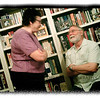 July 28, 2012 - At the office retirement party for Sue, I noticed what a great backdrop Michelle's bookshelf was. Then there was this nice interaction between Sue and her - now - former boss. (When I got it on a bigger screen, I also noticed the cameraphone's shutter speed was a tad slow with the available light in the room.) (225/366)