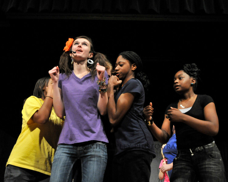 "April 10, 2012 - As cool it is to shoot plays and musicals all around town for the paper, it is even cooler when you get to shoot your own kid's musical for the production. Yay! But even then, you want to get shots that illustrate the action of the show. Here, in School House Rock Live, the singer of ""Elbow Room"" gets elbowed out by the extras. By the way (shameless plug warning), if you want to see Bryan Station High School's ""School House Rock"", it is at 7:30 p.m. April 13 and 14. Tickets are $8 adults and $5 students and kids. (117/366)"