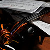 Dec. 19, 2011 - My original plan was to shoot another instrument in our house, working with the light and curves. Cleaning up for that shot, this one caught my eye because it is a testament to (A) No. 1 Son's work ethic practicing his violin and (B) one of our pet peeves with him: not putting the instrument away - I will generously allow this is in part because he intends to be back soon, but still ... Anyway, I did not disturb the scene much - photojournalist in me kicking in - but I did work with an umbrella as both a reflector and softener at various heights and angles over a few dozen shots. (4/366)