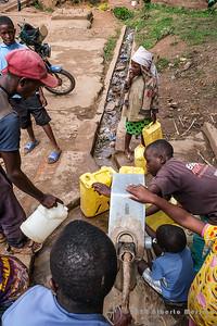 crowd around the water pump