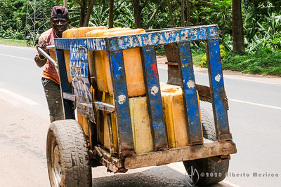 a water merchant en route to the villages to sell water, Kigali, Rwanda