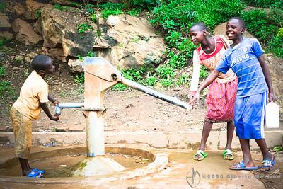 kids at the water pump, Kigali, Rwanda