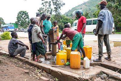 Crowd around the water pump.