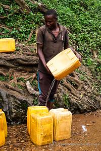 a water merchant filing his jerry cans, Kigali, Rwanda