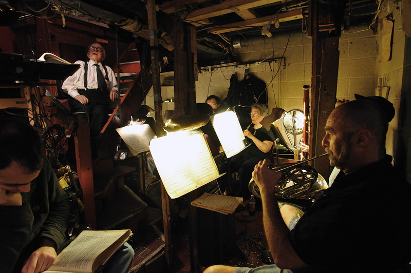 Maestro Anthony (Tony) Amato and musicians in the orchestra pit, below the stage.<br /> Amato Opera Theatre, New York City<br /> © Laura Razzano