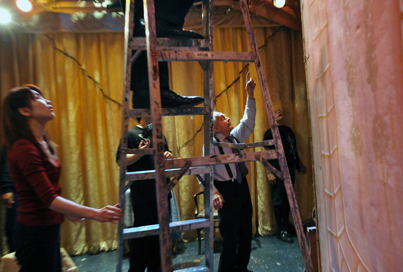 Maestro Anthony (Tony) Amato directs the changing of sets during the intermission between Act II and Act III on the day of the last performance of The Marriage of Figaro.<br /> Amato Opera Theatre, New York City<br /> © Laura Razzano