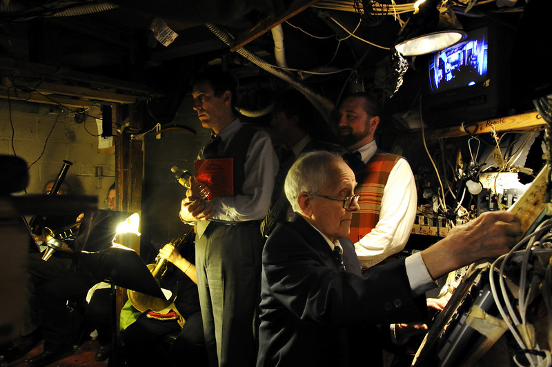 The musician pit under the stage is shared by the light board where Maestro Tony Amato changes lights and add subtitles during The Boheme. Singers also waiting to go up on stage.