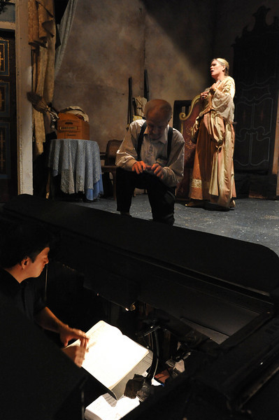 Amato Opera Theatre, New York City.<br /> © Laura Razzano<br /> <br /> Maestro Tony Amato gives the cues to the conductor during rehearsal of The Marriage of Figaro