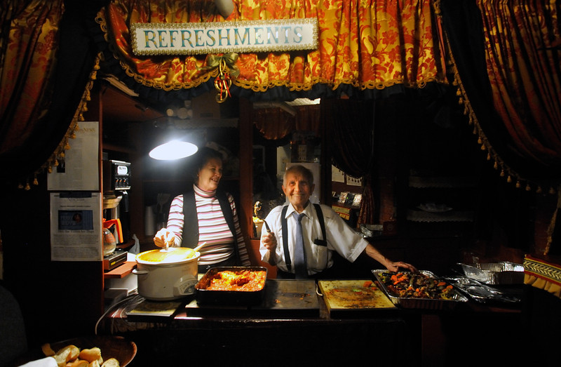 Amato Opera Theatre, New York City.<br /> © Laura Razzano<br /> <br /> (L-R) Lorraine Davidson, singer and Maestro Anthony Amato serve dinner to the volunteers who helped to dismantle sets of La Boheme and to built the stage for to the Marriage of Figaro.