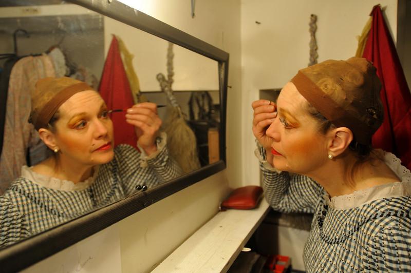Alicia Alexander puts makeup on during The Boheme.<br /> Amato Opera Theatre, New York City.<br /> © Laura Razzano