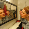 Alicia Alexander puts makeup on during The Boheme.<br /> Amato Opera Theatre, New York City.<br /> © Laura Razzano