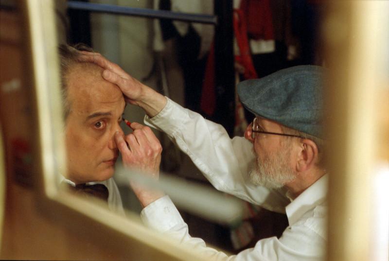 Richard Cerullo (R) scenographer puts makeup on Jerry Kronberg (L), singer at the Theatre. <br /> Amato Opera Theatre, New York City.<br /> © Laura Razzano