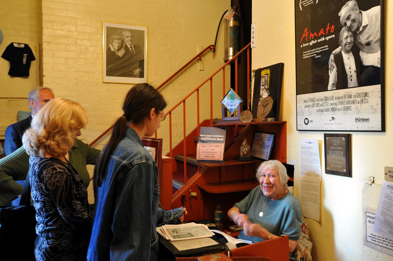 Ann Boney, long time patron of the Amato Opera, working at entrance the box office