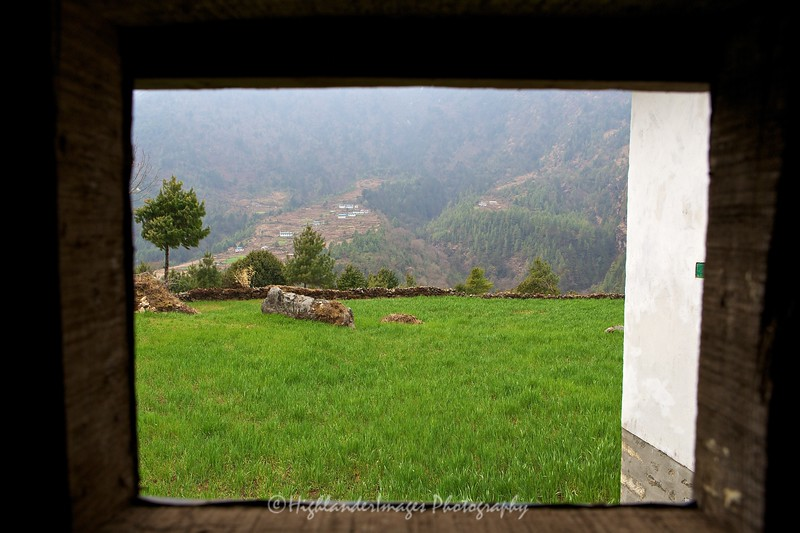 The view from the open window inside a small simple toilet at the side of the trail between Lukla and Phakding