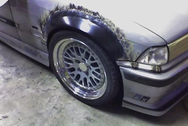 "The ""flare"" section from an OEM E46 sedan front fender grafted to an E36."