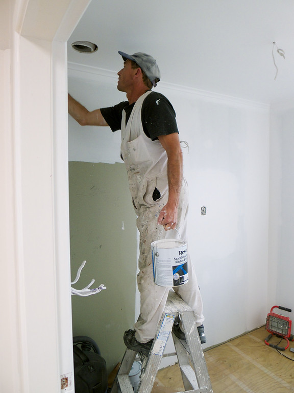Guy Storer  - professional plasterer, painter, tiler, finisher - busy on the job