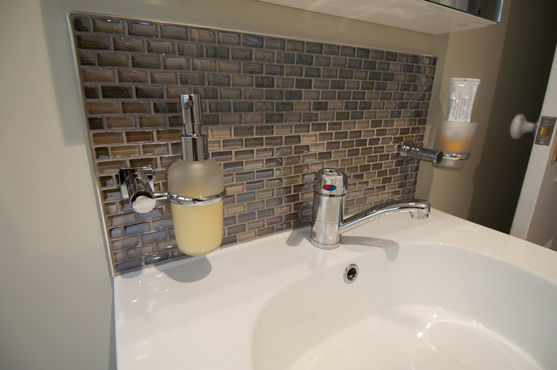 Splahback mosaic tile over wall-hung vanity