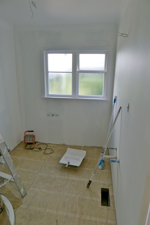 Walls lined and primed.  Floor levelled for new cork tiles