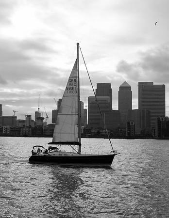Yacht sailing past Canary Wharf