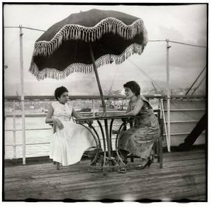 Mary and Mom sit aboard the deck of the Cleopatra docked at Beirut Harbor in 1956 before it set sail for the US.  Original scan in 2003.
