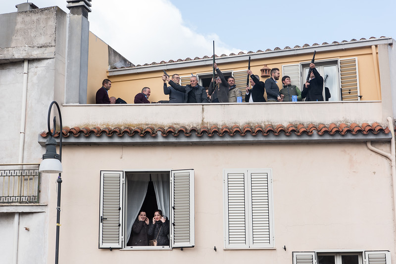"""April 1, 2018  Gunmen on balconies during the celebration of """"s'incontru"""" (the meeting) on Easter Sunday in Oliena, Sardinia, Italy. They shoot in the air to announce Jesus's resurrection and scare away the evil spirits that might interfere with this important day."""