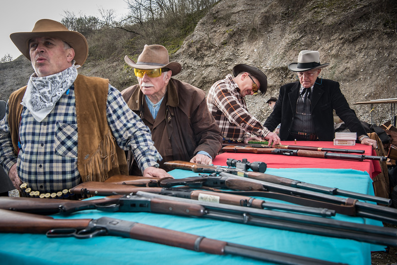 March, 2018 – Verano Brianza, Italy. Cowboy Action is a competition similar to 3 gun except they use old styled firearms. They use a revolver, shotgun and rifle. However they are all manually operated. Single action revolvers are used for the pistols. Side by side, pump (hammered) or lever action shotguns and lever action rifles are used.