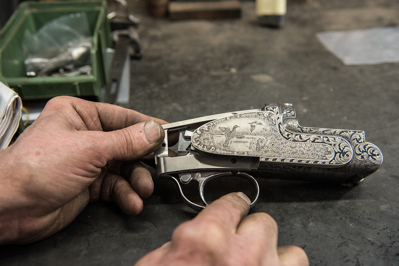 February, 2018 – Val Trompia, Italy. Perugini-Visini's Master Engraver at work. Uses a tiny hammer to engrave an intricate design.