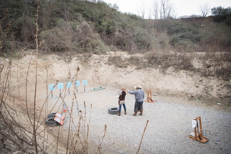 """March, 2018 – Verano Brianza, Italy. A competition of CAS (Cawboy Action Shooting) inside a former quarry in Brianza, currently known as Campo Traversera and home of the """"Canne Tonanti"""" association where all the weekends fans of this discipline dressed in western clothes set up real sets practicing with their revolvers and carbines."""