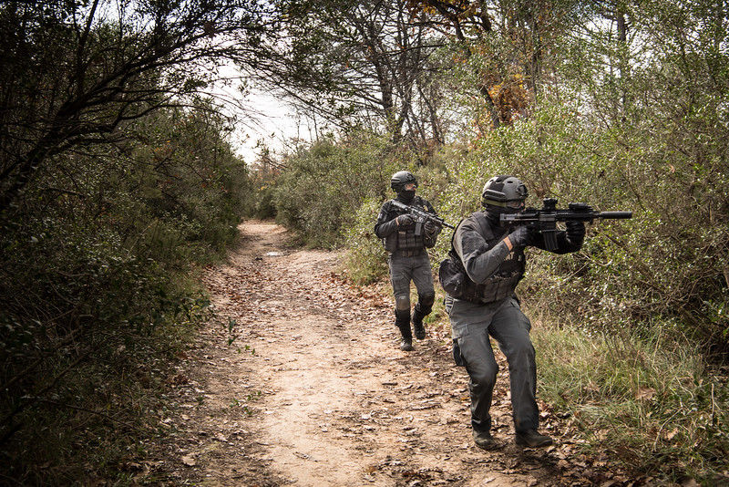 December, 2017 - Nettuno, Italy. Two members of the SWAT during a mission of Softair within the wooded area of Campo Praesidium.