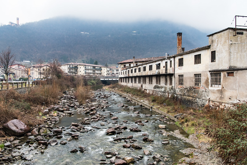 February, 2018 – Val Trompia, Italy. The Mella River divides the Beretta factory.