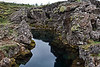 """Peningagjá, the opposite side, from the foot path, of Nikulasárgjá.  People throw coins into the waters of these gorges, but primarily into Peningagjá.  The following description was taken from the interactive map at:  <a href=""""http://thingv.flashmap.gagarin.is/thingv2-en.html"""">http://thingv.flashmap.gagarin.is/thingv2-en.html</a>.<br /> <br /> For about a hundred years, visitors to Þingvellir have thrown coins into Flosagjá and made a wish. Hence this section of the gorge is known as  Peningagjá [Money Gorge]. The coins can be seen glittering on the floor of the gorge, in ice-cold water three metres deep."""
