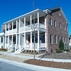 Carolina Commons is located in New Bern, North Carolina. Allison Ramsey Architects designed the mansion flat, row houses and several single family homes.