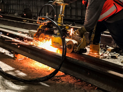 Exothermic Welding at Expo/Crenshaw Station - Rough grinding the excess metal