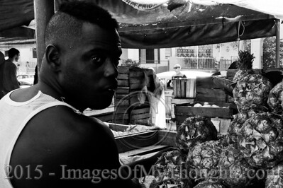 Workers sell agricultural produce in a market in Havana.