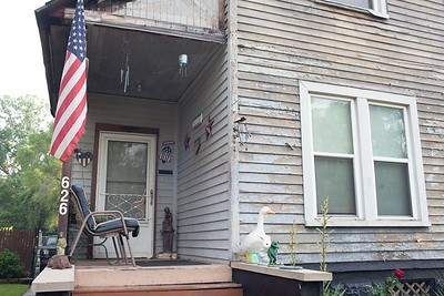 """Sean and his house on Livernois """"the one with all the flowers and American flag"""""""