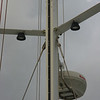 Installing mast tracks.<br /> The track sections are 2 meters each. They have internal couplers at the spots where you see three bolts close together. The upper bolt attached to the mast and the lower two hold the splice.