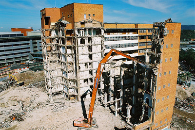 Demolition of the Princess Alexander hospital in Brisbane, showing a Hitachi EX700 high reach excavator